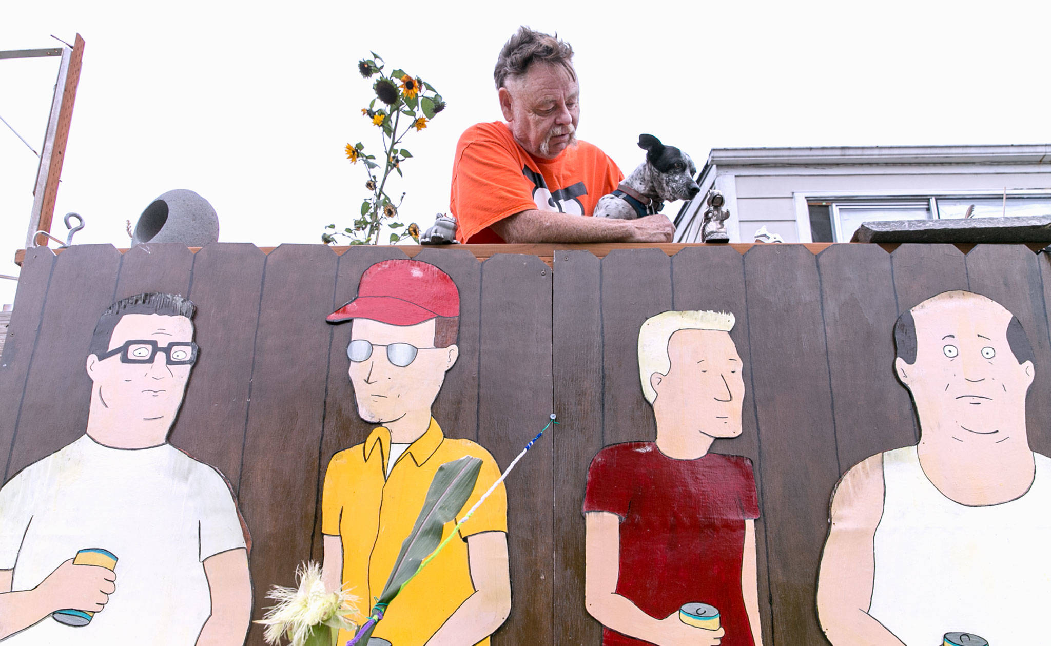 "Kelly Hatley, 63, proudly displays characters from ""King of the Hill"" in his front yard in Freeland on Whidbey Island. (Kevin Clark / The Herald)                                 Kevin Clark / The Herald.                                 <em>Kelly Hatley, 63, proudly displays characters from ""King of the Hill"" in the front yard of his home in Freeland.</em>"