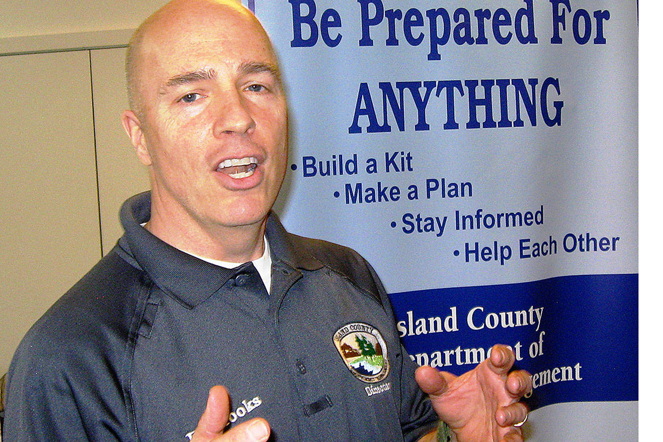 David Felice photo                                 Island County Emergency Management Director Eric Brooks talks about the importance of disaster readiness Saturday at St. Hubert's Church in Langley. Several agencies presented an informal demonstration and discussion of how to be ready for emergencies.