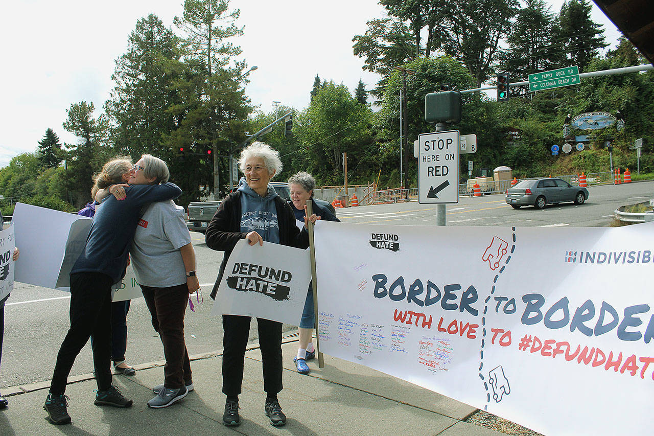 "The ""Border to Border with Love"" banner arrives into Clinton on Sept. 8 as part of a march from Blaine, Wash. to San Diego, Calif. Photo by Wendy Leigh/South Whidbey Record"